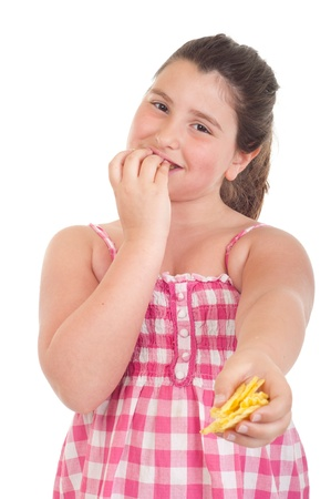 hungry children: cute little girl eating chips and offering some too (isolated on white background)