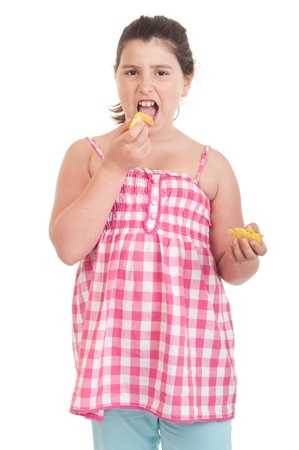 cute little girl with hungry expression eating chips (isolated on white background)