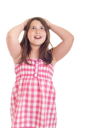 little girl portrait with surprised expression in a pink top (isolated on white background) photo