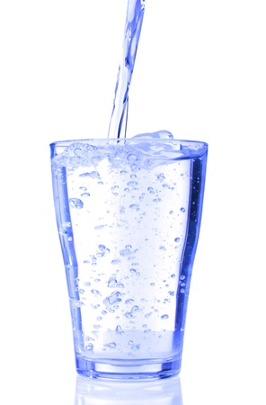 fresh water pouring into a glass isolated on white background photo