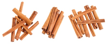 collection of cinnamon sticks isolated on white background Stock Photo
