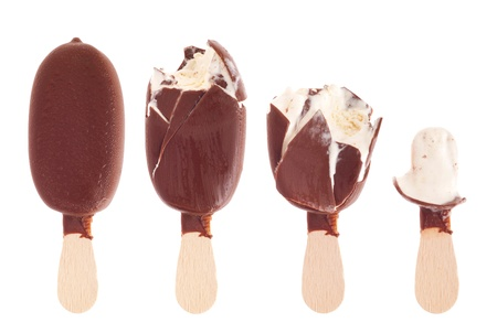 sequential: delicious black chocolate ice cream (being eaten up, sequential images) isolated on white background