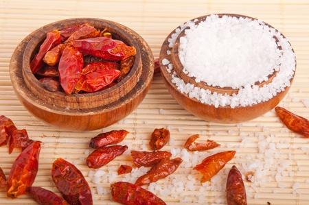 piri: gorgeous setting with piri piri and salt on vintage wooden bowls and mat