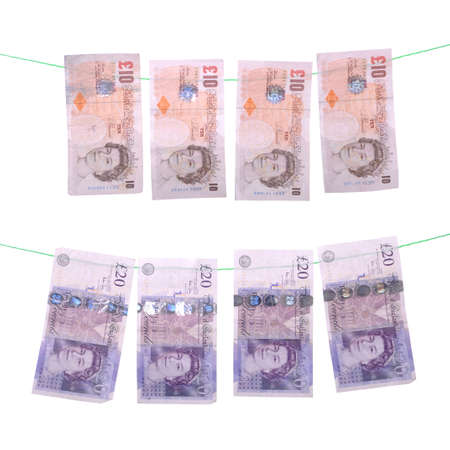 bank note: money laundering concept with pound notes (isolated on white background) Stock Photo