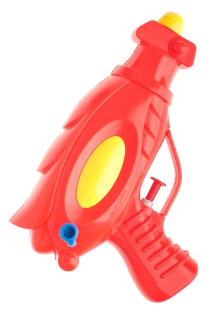 red plastic water gun isolated on white background photo