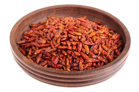 piri: Piri Piri peppers on a vintage wooden bowl (isolated on white background)