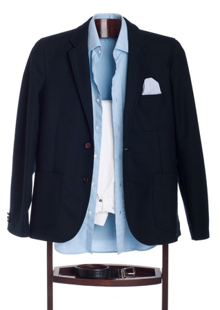 formal man dressing for a celebration, event, job interview or wedding on a wooden hanger (shirt, jacket, trousers and belt) isolated on white background photo