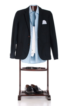 formal man dressing for a celebration, event, job interview or wedding on a wooden hanger (shirt, jacket, trousers, belt and shoes) isolated on white background