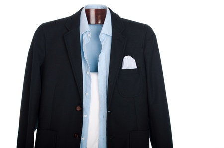 formal dressing: formal man dressing for a celebration, event, job interview or wedding on a wooden hanger (shirt, jacket and trousers) isolated on white background