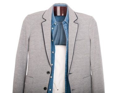 smart casual man dressing for a celebration, event, wedding or night-out on a wooden hanger (shirt, jacket and trousers) isolated on white background Stock Photo - 9966753