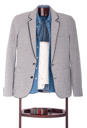 smart casual man dressing for a celebration, event, wedding or night-out on a wooden hanger (shirt, jacket, trousers and belt) isolated on white background photo