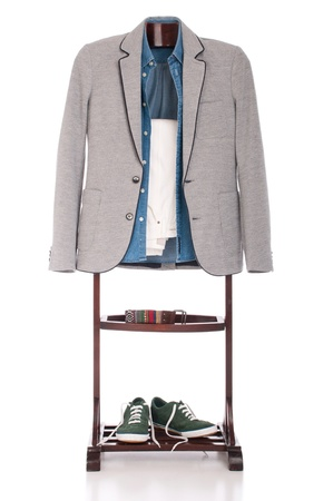 smart casual man dressing for a celebration, event, wedding or night-out on a wooden hanger (shirt, jacket, trousers, belt and stylish sport shoes) isolated on white background Stock Photo