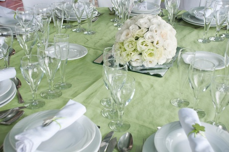 detail of a wedding table set for fine dining with a estomas arrangement Stock Photo