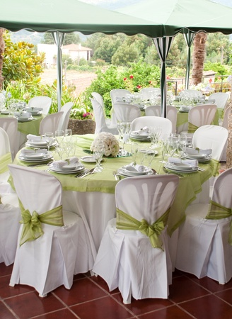 gorgeous wedding chair and table setting for fine dining at outdoors Stock Photo - 9966732