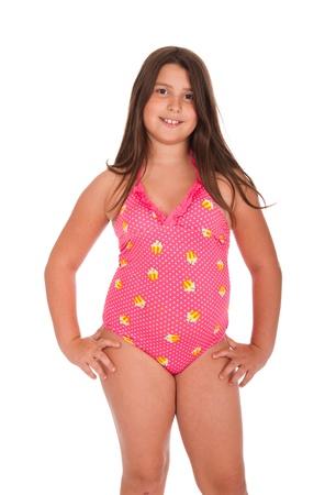 beautiful brunette teenage girl in swimsuit posing (isolated on white background) photo
