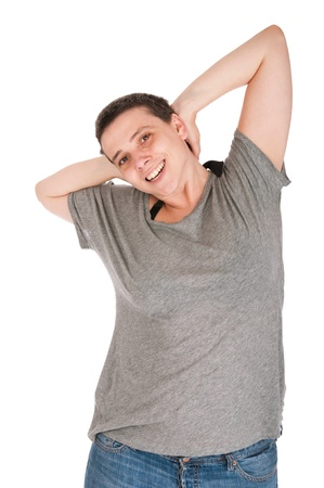smiling casual woman relaxing with arms behind head isolated on white background Stock Photo - 10055397