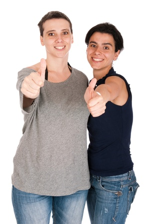 thirties portrait: happy smiling sisters showing thumbs up sign, isolated on white background Stock Photo