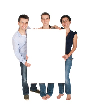 happy smiling brother and sisters holding a banner ad (full length picture, isolated on white background) Stock Photo - 10055407