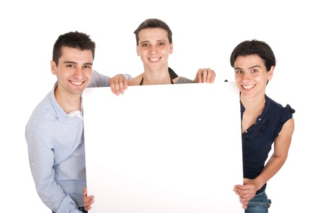 happy smiling brother and sisters holding a banner ad, isolated on white background Stock Photo - 10055409