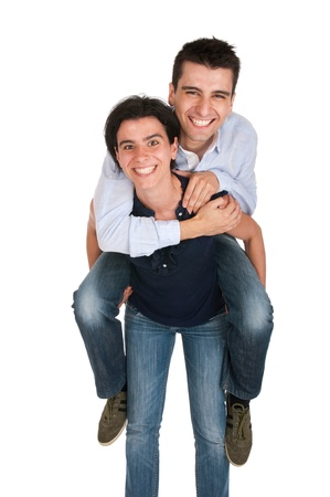 loving sister gives piggyback to her brother, happy hugging (isolated on white background) photo