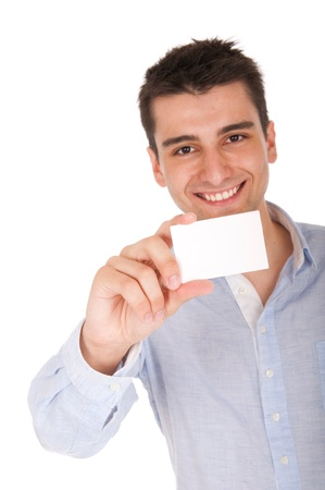 smiling young casual man holding blank white card (focus on hand, isolated on white background)