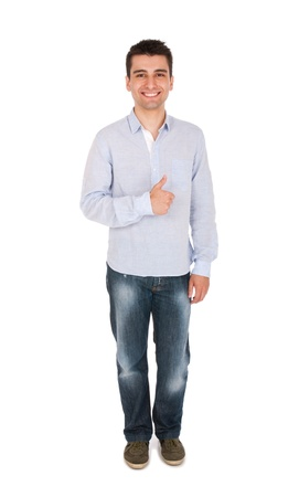 smiling young casual man showing thumbs up sign (full length picture, isolated on white background) photo