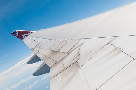 ST JOHNS, ANTIGUA - AUGUST 17: view of Boeing 747 wing of Virgin Atlantic Airways with blue sky clouds close to V. C. Bird International Airport in Antigua on August 17, 2011 in St. John Stock Photo - 10559408