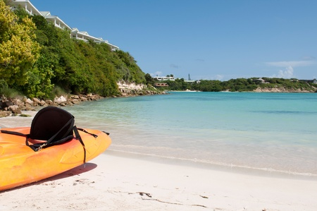 antigua: available orange kayak on a white sandy beach, Long Bay in Antigua