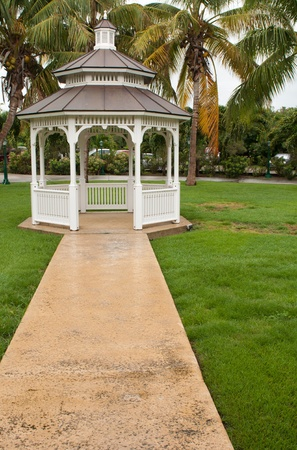 gazebo: pathway to grgeous white gazebo after a tropical storm (outdoor setting)