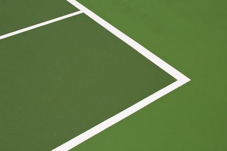 green modern hardcourt tennis as a background or texture photo