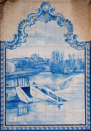 TOMAR, PORTUGAL - DECEMBER 15: beautiful painted ceramic tilework of Nab�o river and Frades weir in Tomar downtown, Portugal on December 15, 2011 in Tomar, Portugal