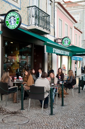 LISBON, PORTUGAL - DECEMBER 19: people having a break at Starbucks coffee esplanade on December 19, 2011 in Lisbon, Portugal. Starbucks is the largest coffeehouse company in the world with 18,887 stores