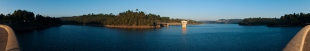 bode: stunning view of river Zezere and Castelo de Bode Dam in Tomar, Portugal (panoramic picture with gorgeous blue sky)