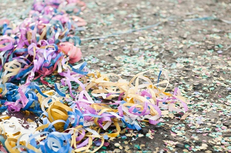 colorful confetti and streamers at the street after Carnival Parade photo