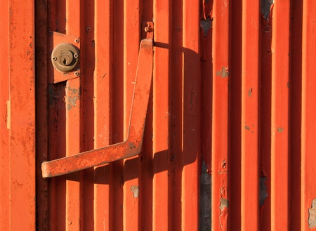 vibrant orange rusty iron door as a background or texture photo