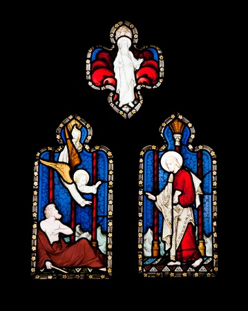 religious stained glass windows in Gloucester Cathedral, England (United Kingdom) (isolated on black background) Stock Photo - 13143953