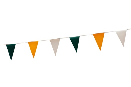 colorful festive green, yellow and white bunting flags (isolated on white background) photo
