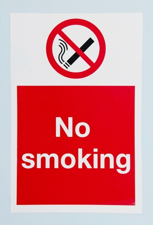 no smoking sign against a blue wall background photo