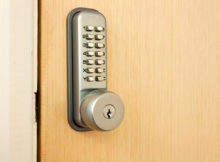 number lock: door lock with keypad outside laboratory room