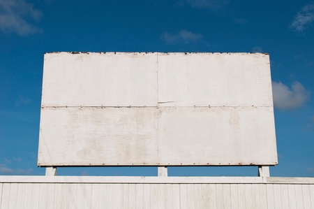 wooden billboard against a blue sky background Stock Photo - 13144491