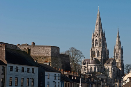 Cork cityscape featuring at the left Elizabeth Fort and on the right Saint Fin Barres Cathedral, Ireland (blue sky background) photo