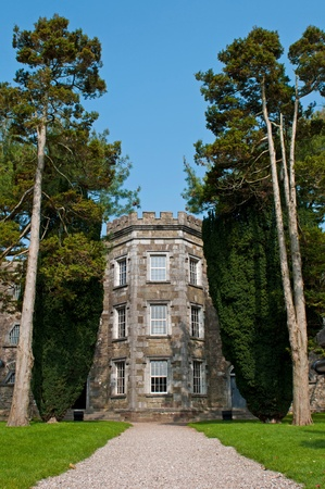 gaol: historical Cork City Gaol prison in Cork, Ireland  stunning garden trees and blue sky