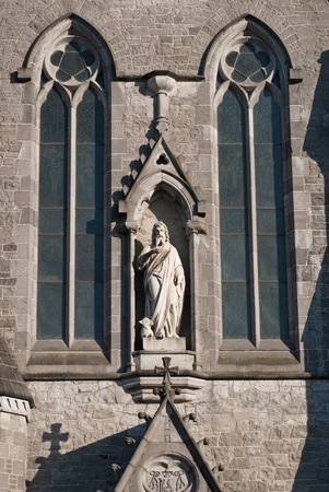 marble sculpture and windows at Saint John Stock Photo