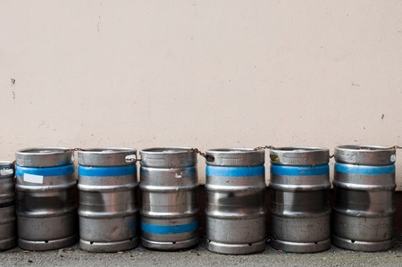 row of beer kegs against a light pink wall  copy-space available Stock Photo - 13238004