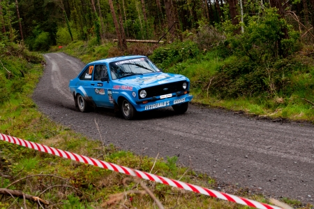 MALLOW, IRELAND - MAY 19: P. Fitzgerald driving Ford Escort at the Jim Walsh Cork Forest Rally on May 19, 2012 in Mallow, Ireland. 4th round of the Valvoline National Forest Rally Championship.