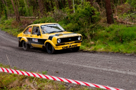 MALLOW, IRELAND - MAY 19: J. Deane driving Ford Escort at the Jim Walsh Cork Forest Rally on May 19, 2012 in Mallow, Ireland. 4th round of the Valvoline National Forest Rally Championship. Stock Photo - 13760651