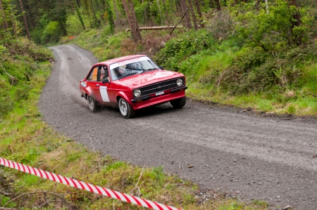MALLOW, IRELAND - MAY 19: J. Cullinane driving Ford Escort at the Jim Walsh Cork Forest Rally on May 19, 2012 in Mallow, Ireland. 4th round of the Valvoline National Forest Rally Championship. Stock Photo - 13760732