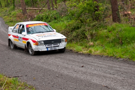 MALLOW, IRELAND - MAY 19: M. Sheedy driving Ford Escort at the Jim Walsh Cork Forest Rally on May 19, 2012 in Mallow, Ireland. 4th round of the Valvoline National Forest Rally Championship. Stock Photo - 13760690