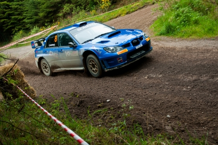 MALLOW, IRELAND - MAY 19: M. Cairns driving Subaru Impreza at the Jim Walsh Cork Forest Rally on May 19, 2012 in Mallow, Ireland. 4th round of the Valvoline National Forest Rally Championship. Stock Photo - 13760773