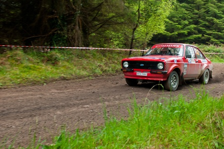 MALLOW, IRELAND - MAY 19: A. Commins driving Ford Escort at the Jim Walsh Cork Forest Rally on May 19, 2012 in Mallow, Ireland. 4th round of the Valvoline National Forest Rally Championship. Stock Photo - 13760626